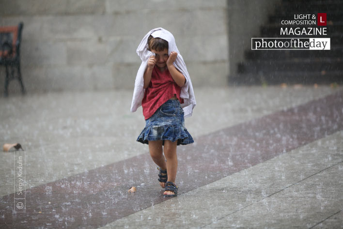 Running in the rain, by Sergiy Kadulin