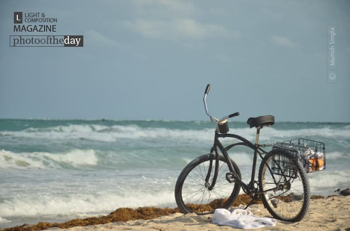 A Bike on the Shores, by Munish Singla