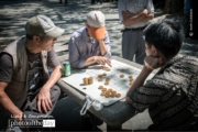 Men Playing Chinese Chess, by Keith Goldstein