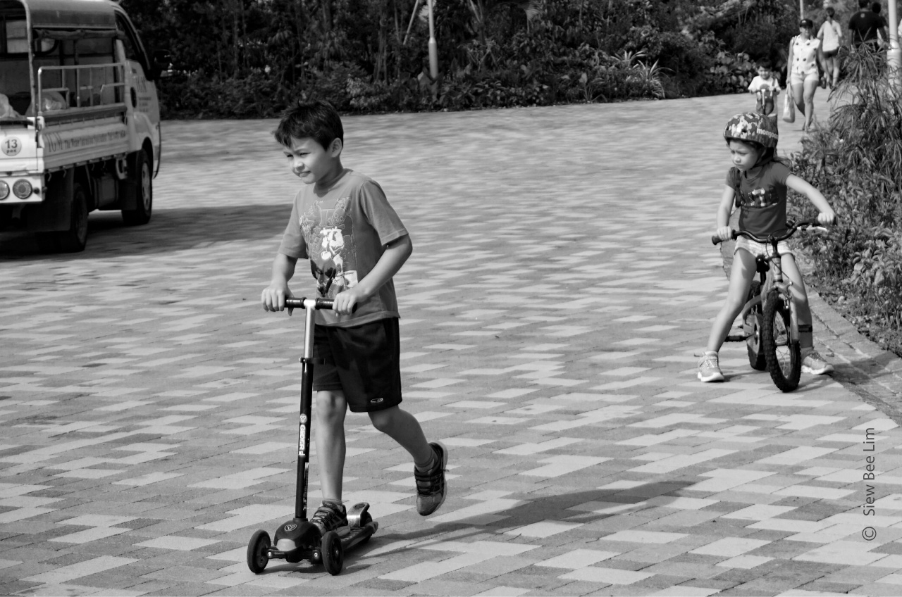 Playing Push Scooter by Siew Bee Lim